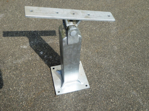 See-saw bearing with post and ground plate